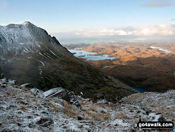 Snow on Bod a' Mhadail with Loch Sionasgaig in the distance  from the summit of Cul Mor