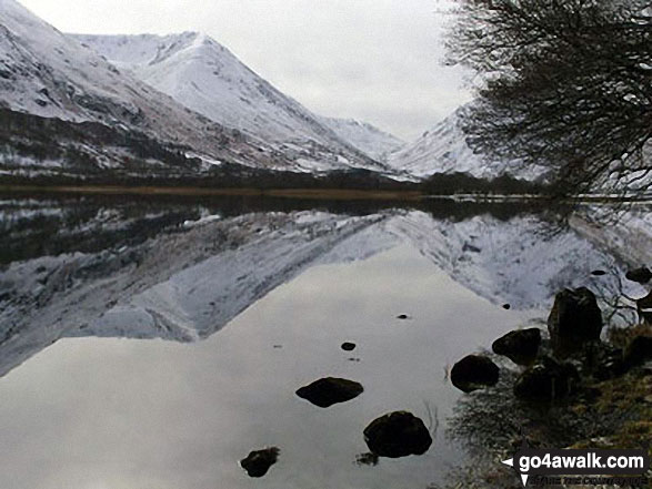 The lower slopes of Hartsop Dodd (left), Caudale Head, The Kirkstone Pass and High Hartsop Dodd (right, behind the tree) reflected in Brothers Water in the snow