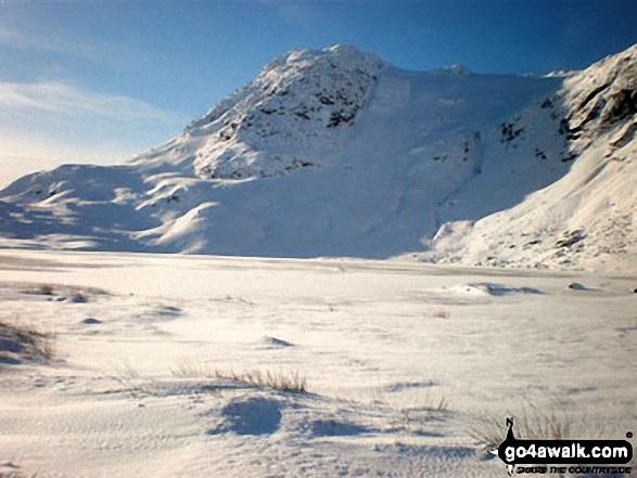 Snow on Harrison Stickle across a frozen Stickle Tarn