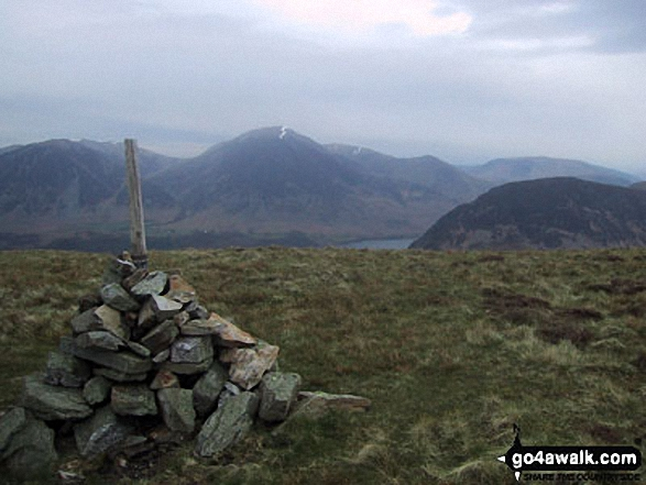 The cairn on the North West end of the Carling Knott ridge with Whiteside (Crummock), Grasmoor, Crummock Water and Mellbreak beyond