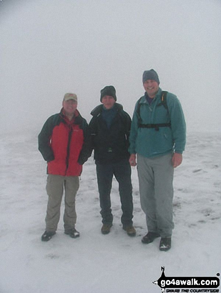 John, Andy and myself on High Street in the snow. Walk route map c128 The Hayswater Round from Hartsop photo