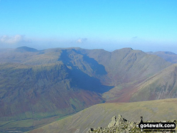 The Mosedale Horseshoe - Yewbarrow (mid-distance left), Red Pike (Wasdale) and Little Scoat Fell beyond, Pillar (right of centre) and the shoulder of Kirk Fell (mid-distance right) from Scafell Pike. Walk route map c215 Scafell Pike from Seathwaite photo