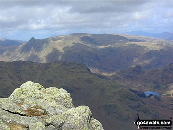 Looking across Little Langdale to the Langdale Pikes (with Pike of Stickle prominent to the left) from Wetherlam