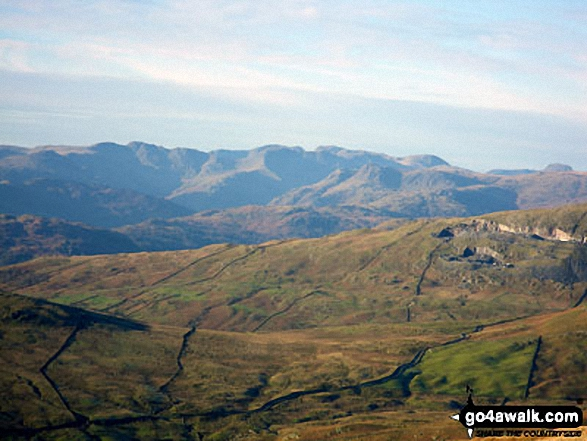 Sca Fell, Scafell Pike and the dome of Great Gable in the distance beyond Crinkle Crags and Bow Fell (Bowfell) with The Langdale Pikes in the mid distance from Yoke