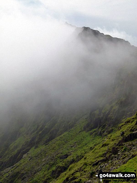 The summit of Snowdon in the clouds from the top of the PYG Track. Walk route map gw136 The Snowdon (Yr Wyddfa) Horseshoe from Pen y Pass photo