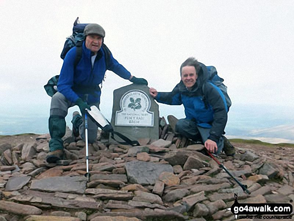 Mick and Rob, friends of 40 years make it to the top of a windswept Pen Y Fan