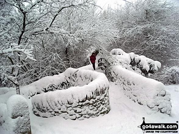 Footbridge under a deep layer of snow in Little Hayfield