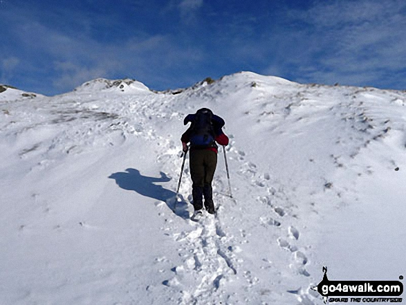 Walk c216 Great Rigg and Heron Pike from Grasmere - Me & my shadow approaching Great Rigg in the snow