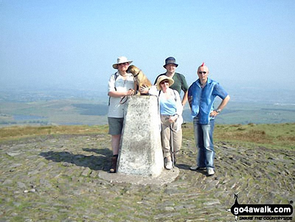 Graham, Oscar, Nina, Sean and Chuts on Pendle Hill in  Lancashire England