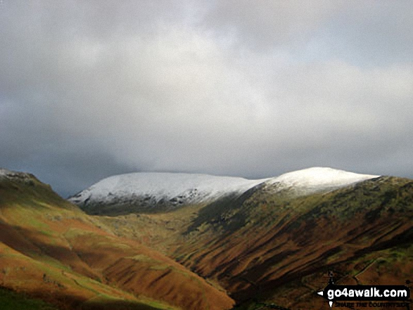 Walk c350 Helm Crag from Grasmere - Helvellyn (centre left) and Seat Sandal (right) above The Pass of Dunmail Raise from Helm Crag