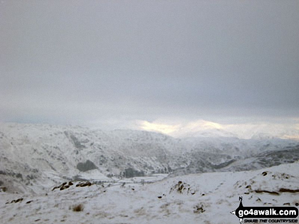 Great Langdale and Blea Rigg with The Helvellyn Massiff in the distance under a deep blanket of snow from the lower slopes of Pike of Blisco (Pike o' Blisco)