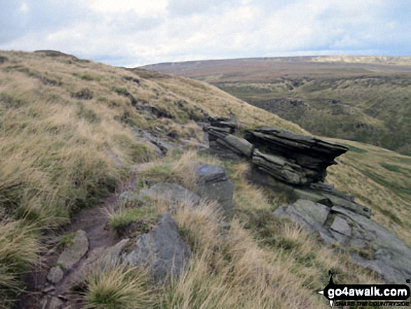 The Pennine Way on Black Chew Head (Laddow Rocks) with Black Hill (Soldier's Lump) in the distance