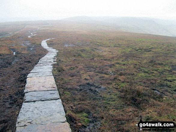The paved path between Brown Knoll and South Head (Hayfield). Walk route map d156 Kinder Low (Kinder Scout), Brown Knoll (Edale), South Head (Hayfield) and Mount Famine from Bowden Bridge, Hayfield photo