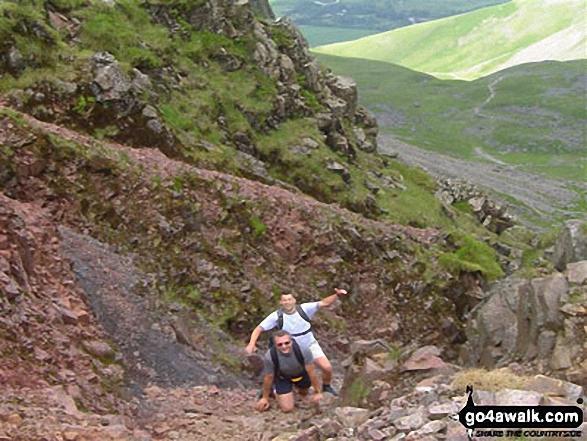 40 year old peak baggers on Scafell Pike walk The Lake District Cumbria England walks