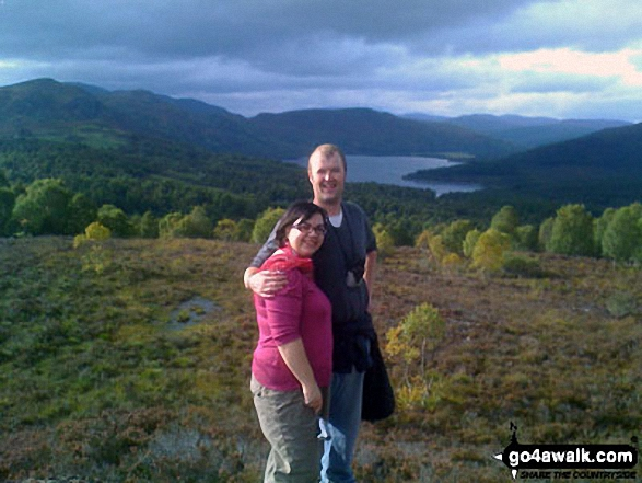 My husband and I on Cnoc Dubh (with Loch na Croic in the background) above Strathpeffer in the Scottish Highlands