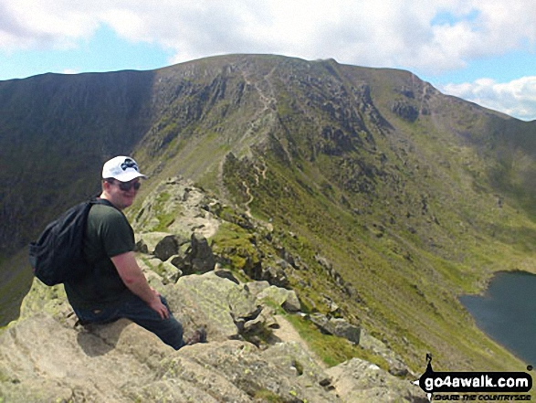 Walk c264 The Grisedale Round from Patterdale - On Striding Edge with Helvellyn summit beyond