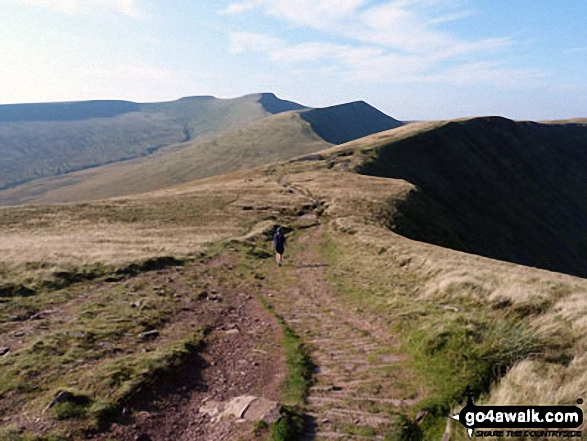 Me striding out across Craig Cwmoergwm with Corn Du (centre - distance), Pen y Fan, Cribyn amd Fan y Big (far right).