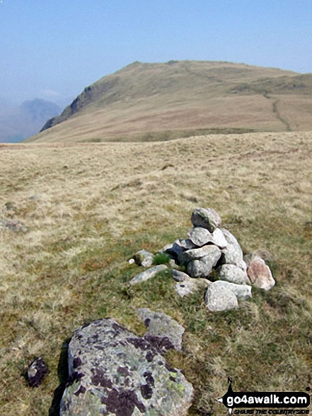 Irton Fell summit cairn with Whin Rigg in the background
