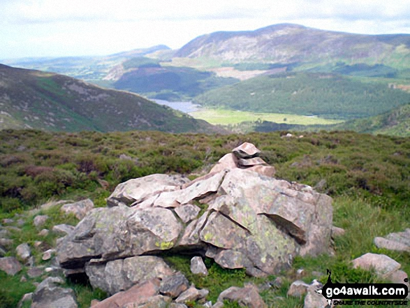 Cairn on the ridge between Sliver Cove Beck and Deep Gill with Ennerdale Water, Great Borne and Starling Dodd beyond. Walk route map c130 Haycock and Steeple from Ennerdale Water photo