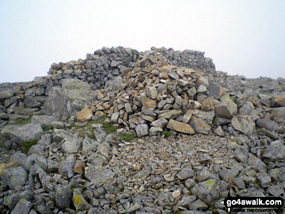 Haycock summit cairn during a break in the mist. Walk route map c130 Haycock and Steeple from Ennerdale Water photo