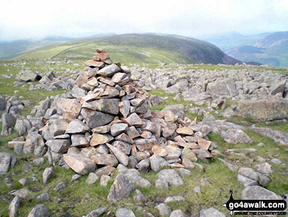 Caw Fell summit cairn with Iron Crag beyond
