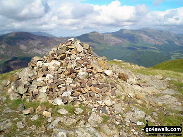 Crag Fell summit cairn with Great Borne (left), Starling Dodd (centre), Red Pike (Buttermere) and High Stile in the distance