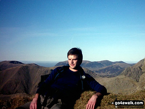 Relaxing on Scafell Pike summit. Walk route map c215 Scafell Pike from Seathwaite photo