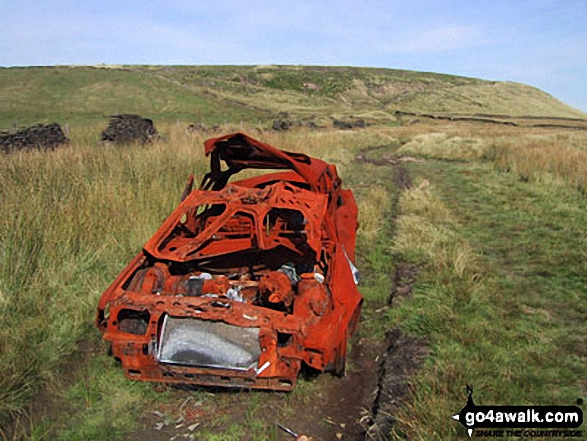 An abandoned car on Cowpe Lowe. Walk route map l210 Cowpe Lowe from Edenfield photo