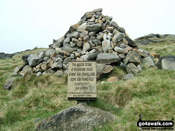 The Aiggin Stone plaque and cairn on Blackstone Edge