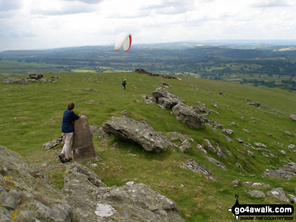 Waiting for a paraglider to take-off on Sourton Tors