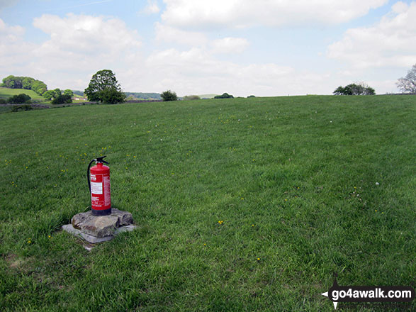 Fire Extinguisher in an empty field at Hulme End Campsite Preparation is everything.