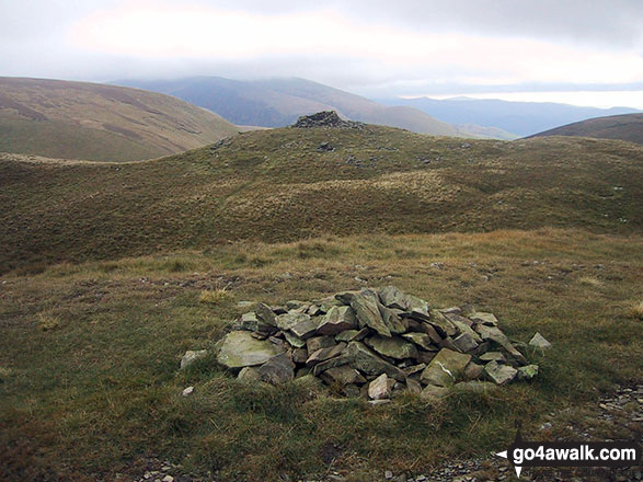 Stone wind shelter on Meal Fell from the summit cairn