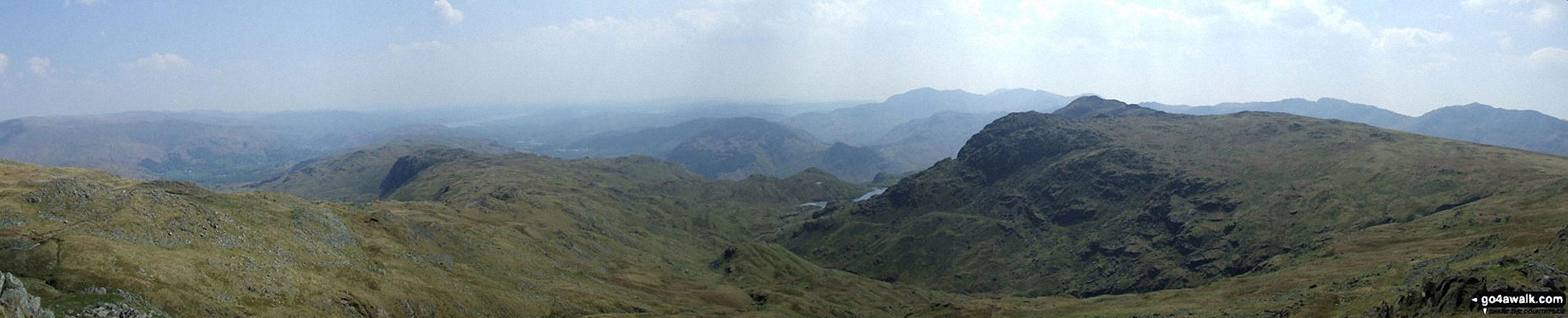 The view from Sergeant Man featuring Blea Rigg (centre left), Lingmoor Fell (centre distance), Stickle Tarn (partially hidden) and Pavey Ark with Harrison Stickle beyond (The Langdale Pikes) (centre right)