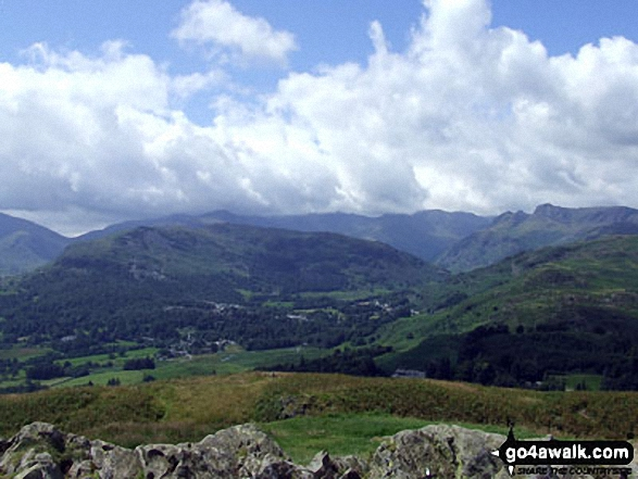 On the summit of Loughrigg Fell, looking towards Elterwater with the Langdale Pikes to the right