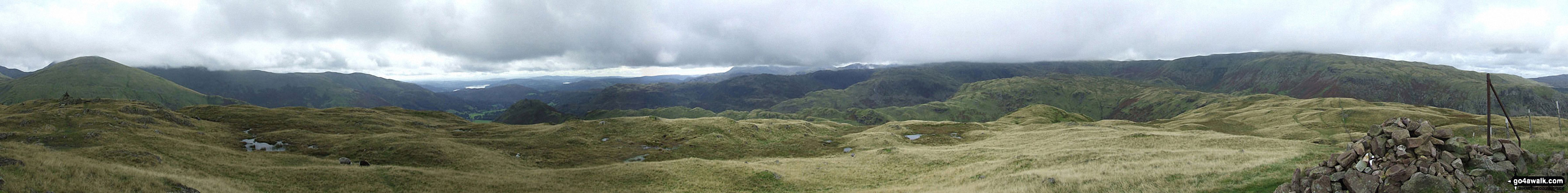 Helm Crag, Gibson Knott, Calf Crag, Greenup Edge and The Wythburn Fells from Steel Fell (Dead Pike) summit cairn