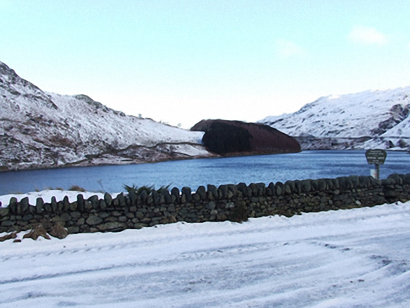 The Rigg and Haweswater Reservoir from Mardale Head car park in the snow. Walk route map c114 High Street from Mardale Head photo
