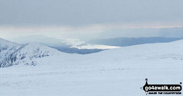 A distant Lake Windermere from the summit of High Street in the snow. Walk route map c128 The Hayswater Round from Hartsop photo