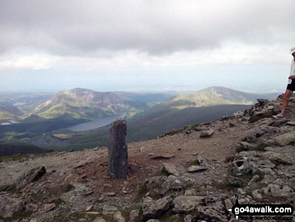 Post marking the pint where the Watkin Path joins Snowdon (Yr Wyddfa)'s South ridge above Bwlch Main - with Mynydd Mawrm Llyn Cwellyn and Moel Eilio in the distance. Walk route map gw105 Snowdon via The Watkin Path from Nantgwynant photo