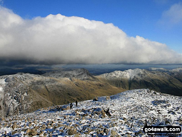 Snow on Esk Pike (left), Bow Fell (Bowfell) and Crinkle Crags (right) from the summit of Scafell Pike. Walk route map c416 Scafell Pike from The Old Dungeon Ghyll, Great Langdale photo