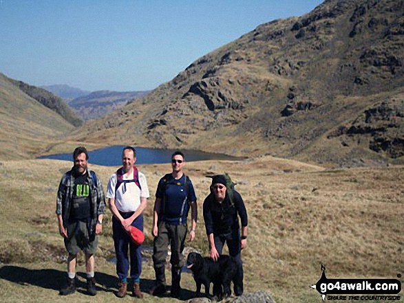 Scafell re-visted. Me, my dog and my mates passing Styhead Tarn on the way up to Scafell Pike. Walk route map c215 Scafell Pike from Seathwaite photo