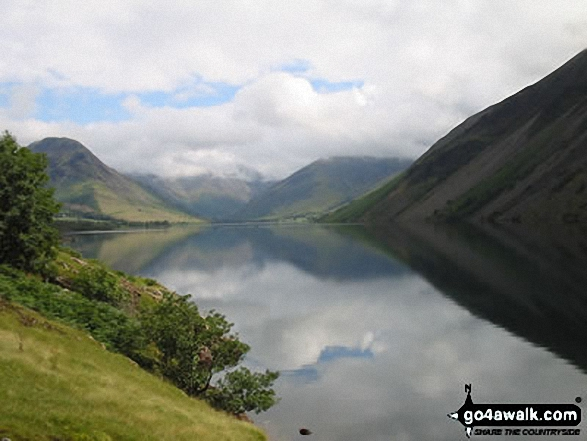 Yewbarrow (left), Great Gable (in cloud centre), Lingmell (centre right) and the Wast Water screes (right) reflected in Wast Water. Walk route map c101 Pillar and Little Scoat Fell from Wasdale Head, Wast Water photo