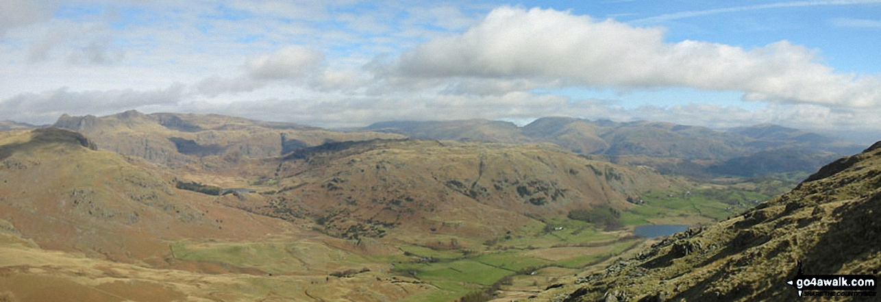 *Little Langdale with the Langdale Pikes, Helvellyn and Fairfield beyond from          Wetherlam