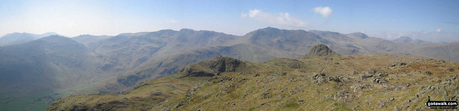 Pike of Blisco (Pike o' Blisco), Crinkle Crags (South Top), Crinkle Crags (Long Top), Gunson Knott, Bow Fell (Bowfell), The Scafell Massif, Great Gable and Pike of Stickle (in the foreground) from Harrison Stickle