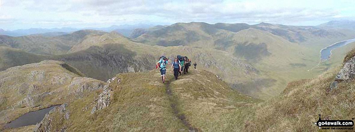 Approaching Bidein a' Choire Sheasgaich with Loch Monar far below (right)