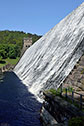 Water cascading over Howden Reservoir Dam The Dark Peak Area The Peak District National Park Derbyshire England