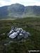 Foel Hafod-fynydd summit cairn with Aran Fawddwy looming beyond