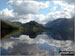 The shoulder of Grasmoor (left), Robinson, Rannerdale Knotts (centre) and the High Stile Ridge (High Crag, High Stile and Red Pike (Buttermere) reflected beautifully in a very still Crummock Water taken from the north west shore below Mellbreak