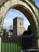 Chastleton Church through the gates of Chastleton House The Cotswolds  Gloucestershire England